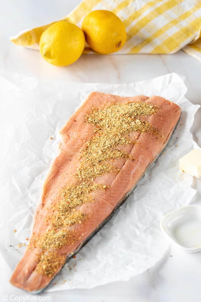 salmon seasoned with lemon pepper and two lemons