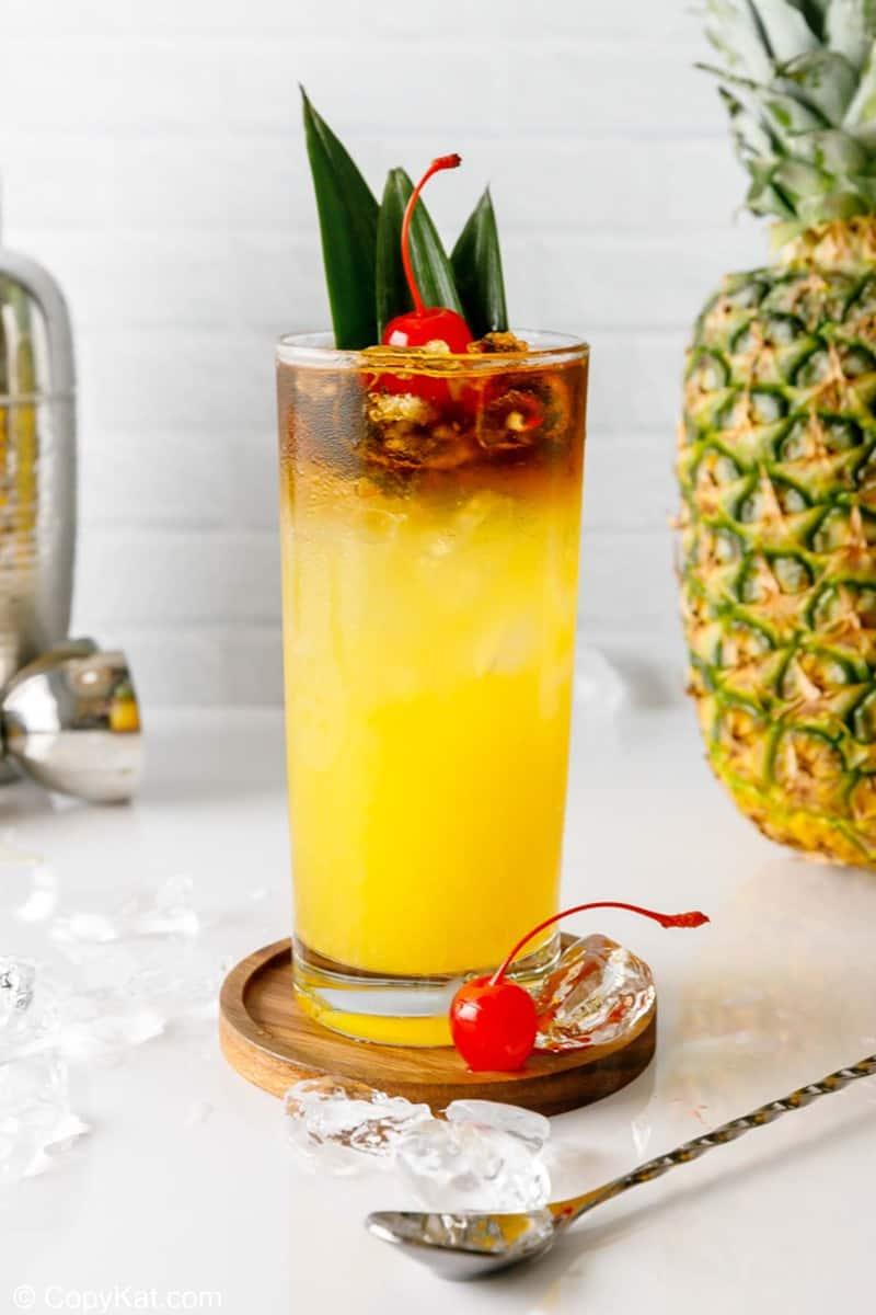 homemade PF Chang Mai Tai, pineapple, and cocktail shaker