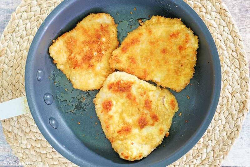 browned panko breaded pork loin cutlets in a skillet