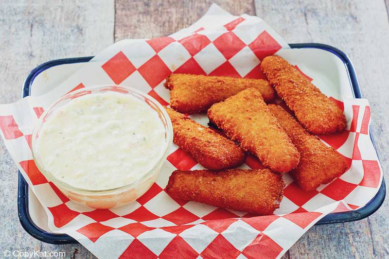homemade tartar sauce and fried fish on a serving tray