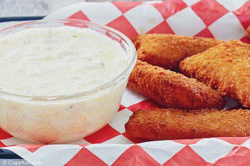 a bowl of homemade Red Lobster tartar sauce and fried fish