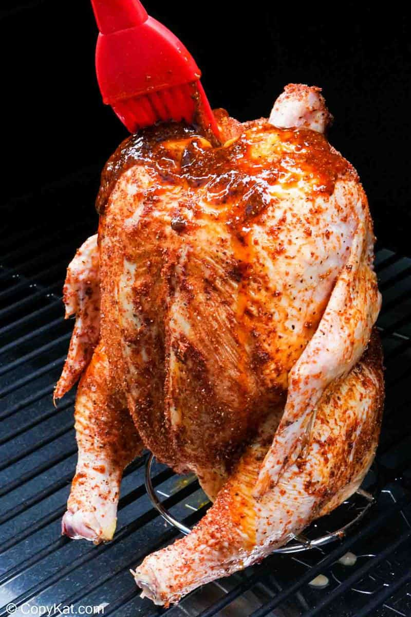 basting beer can chicken in a smoker