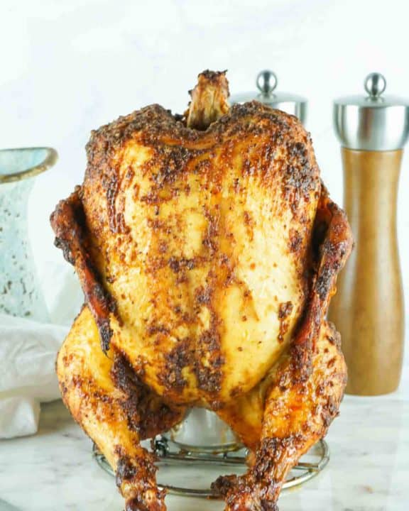 smoked beer can chicken on a holder
