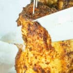 knife slicing smoked beer can chicken