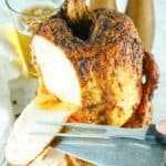 carving slices from smoked beer can chicken
