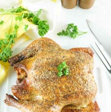 whole smoked chicken and fresh parsley