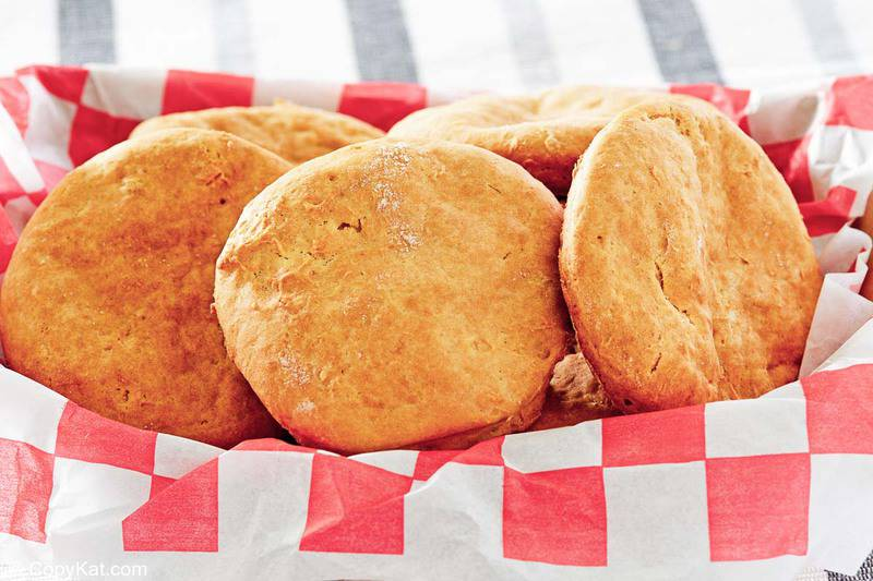 sour cream biscuits on parchment paper in a basket