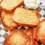 texas toast slices and a bowl of parmesan cheese