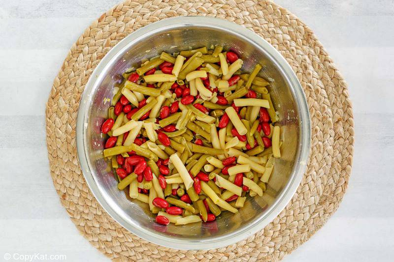 green, red, and wax beans in a bowl