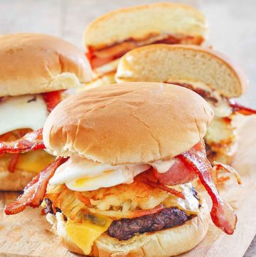 homemade Whataburger breakfast burgers on a wood board