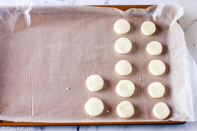 peppermint candy patties on a baking sheet