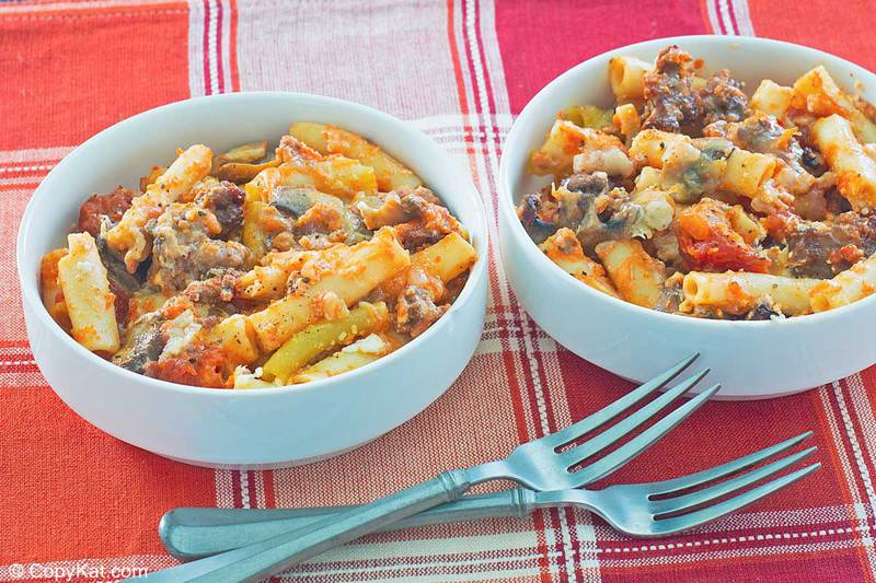 bowls of baked ziti and forks