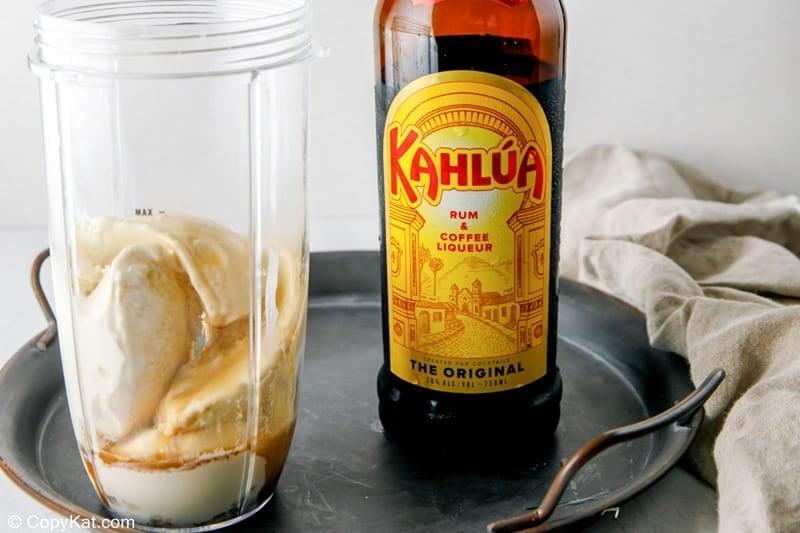adding Kahlua to blender for a brandy alexander