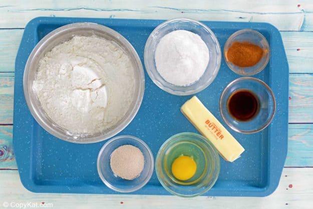 bread machine cinnamon rolls ingredients on a tray