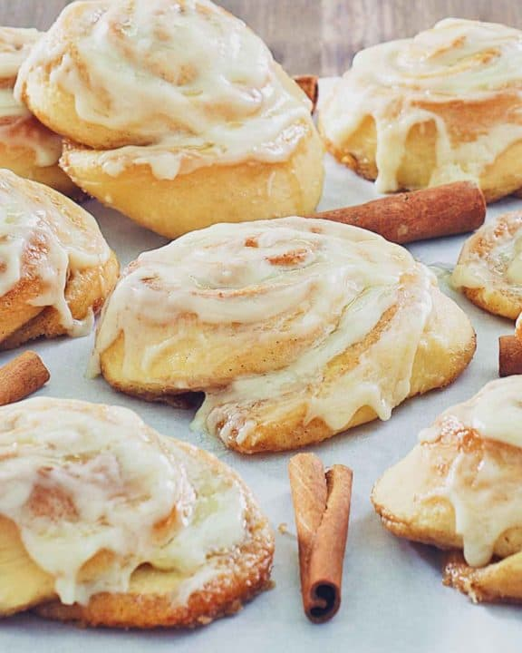 frosted cinnamon rolls and cinnamon sticks