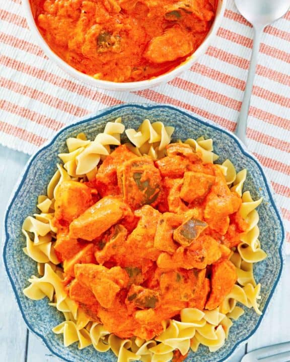 chicken paprikash in a bowl and on noodles
