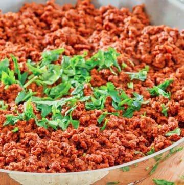 chili colorado con carne in a skillet
