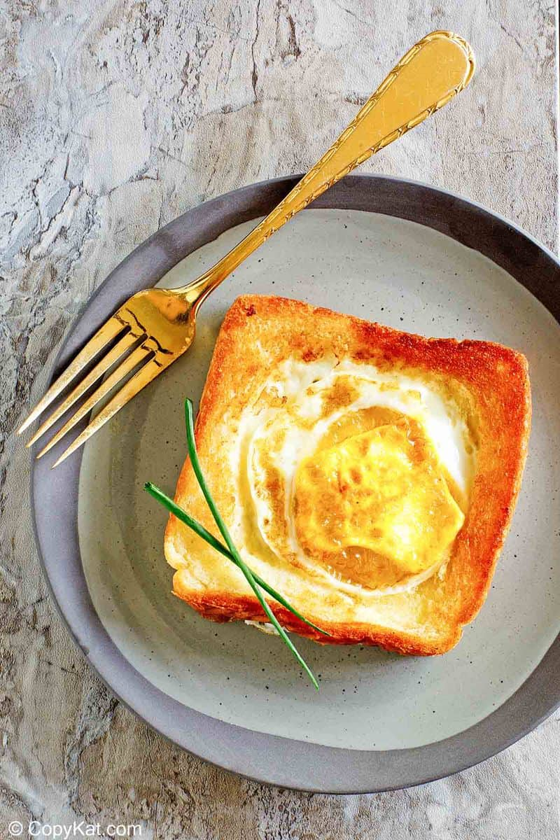 overhead view of egg in a basket and a fork on a plate
