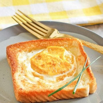 egg in a basket and a fork on a plate