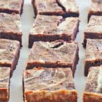 cream cheese brownies on a baking sheet