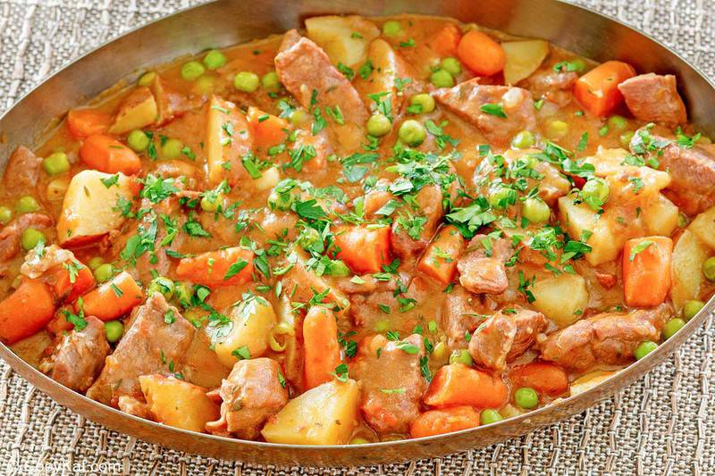 lamb stew with potatoes, carrots, and peas