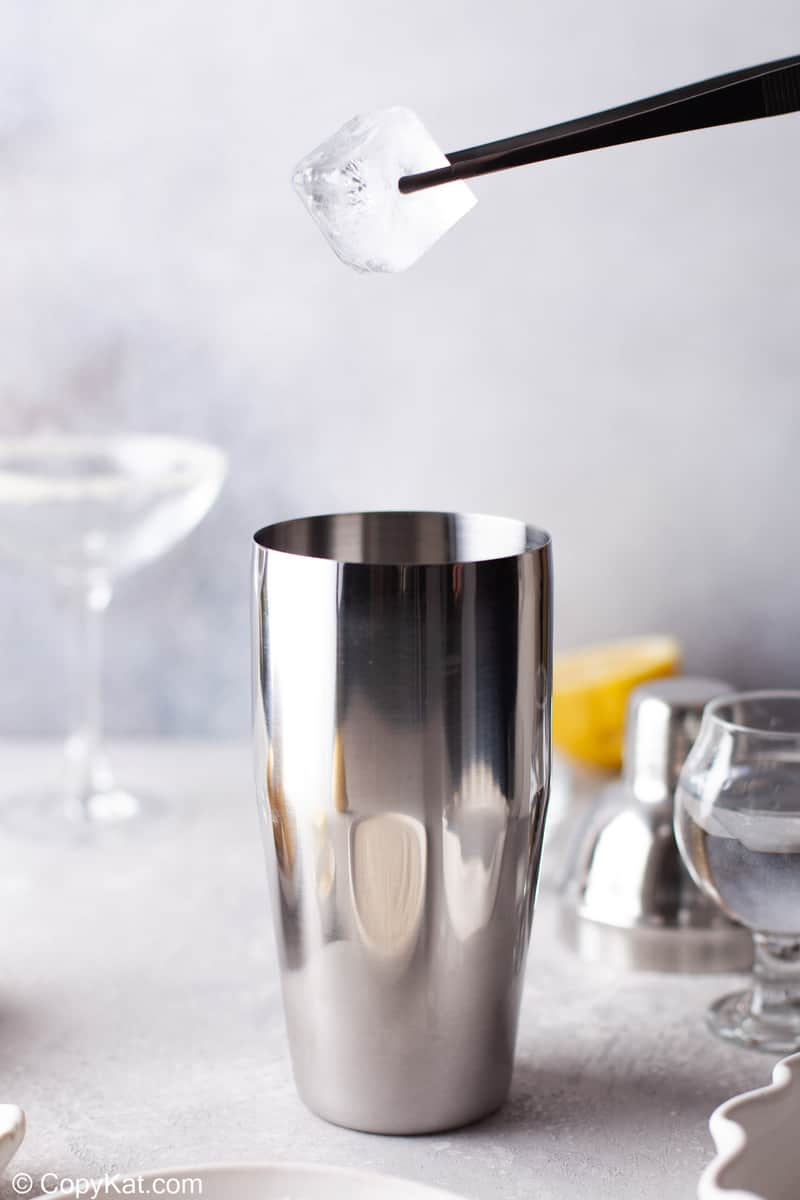 putting ice in a cocktail shaker