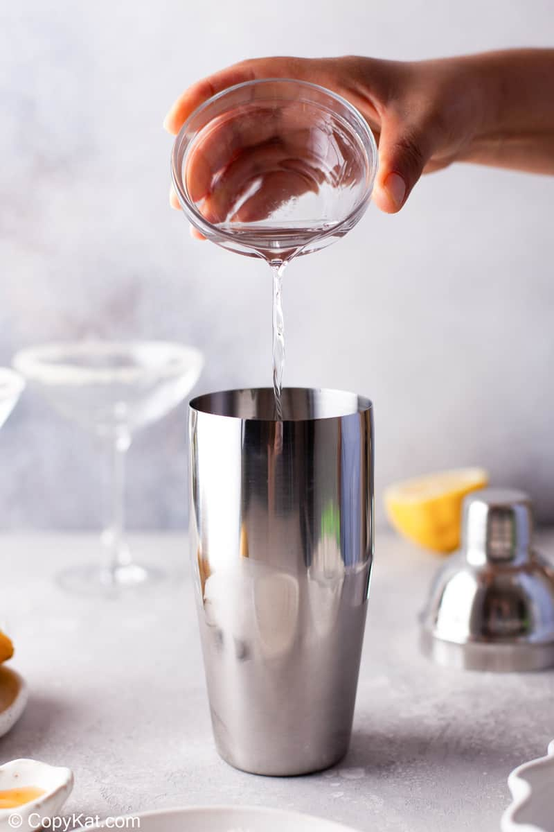pouring Cointreau in a cocktail shaker