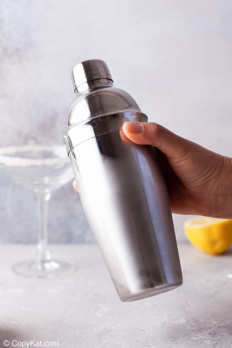 shaking a cocktail shaker