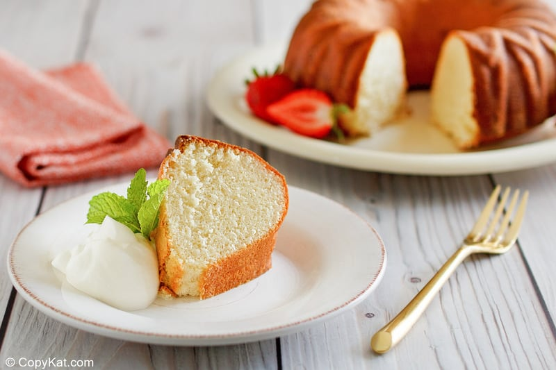 a slice of Scandinavian almond cake and whipped cream on a plate