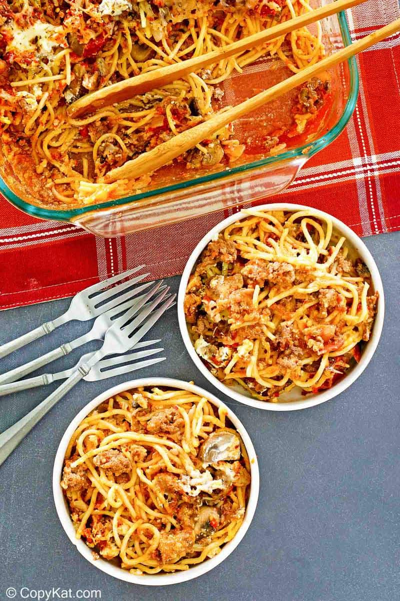 spaghetti casserole in a baking dish and two bowls