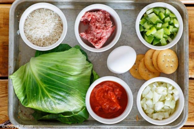 stuffed cabbage rolls ingredients on a tray