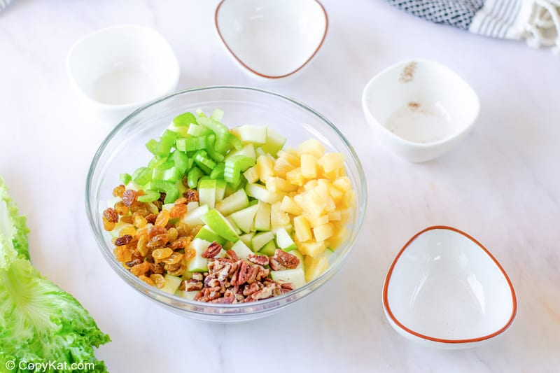fruit and pecans for Waldorf salad in a bowl