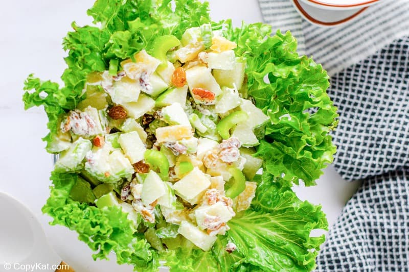 overhead view of Waldorf salad in a lettuce-lined bowl