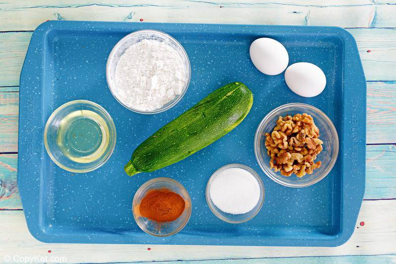 zucchini cake ingredients on a tray