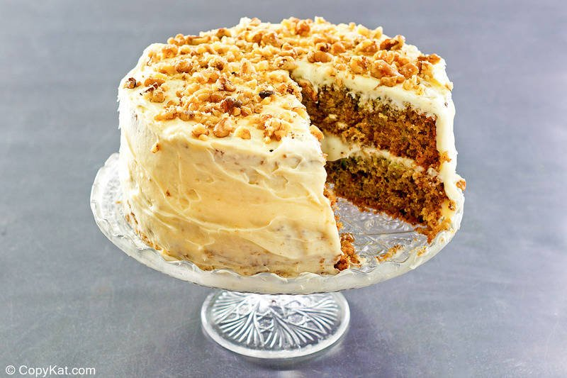 zucchini cake with cream cheese frosting on a stand