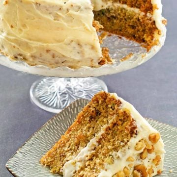 zucchini cake on a cake stand and a slice on a plate