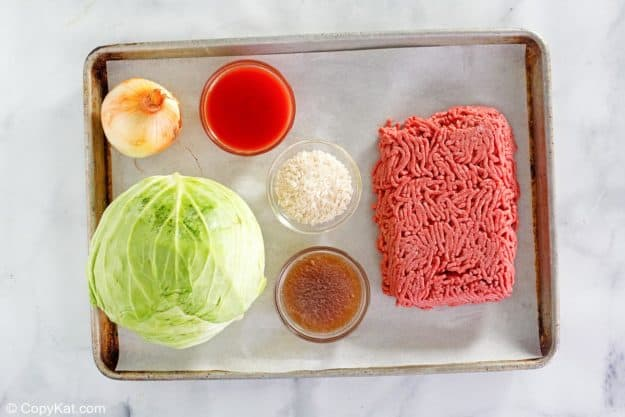cabbage roll casserole ingredients on a baking sheet.