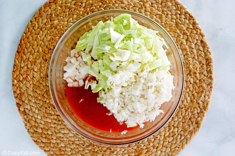 cabbage roll casserole ingredients in a mixing bowl.