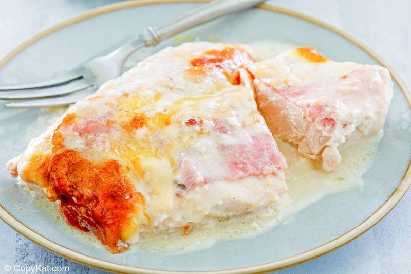 a serving of chicken cordon bleu casserole and a fork on a plate.