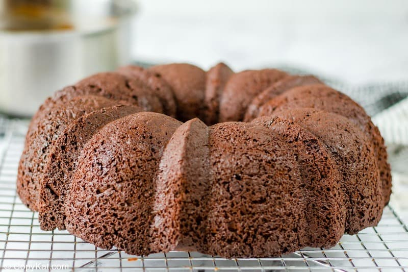chocolate bundt cake on a wire cooling rack.
