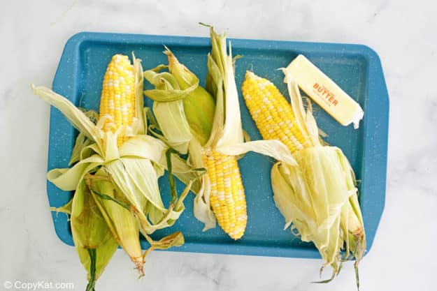 grilled corn on the cob ingredients on a tray.
