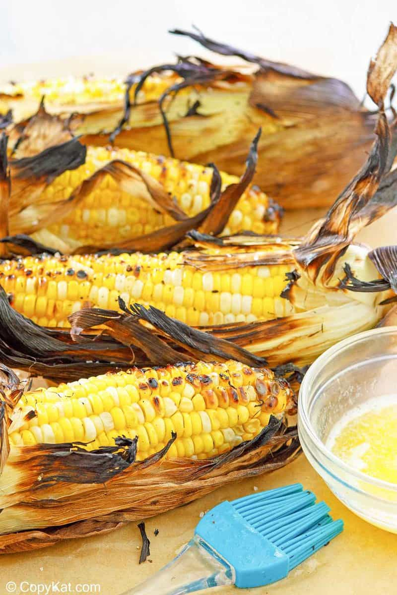 four ears of grilled corn on the cob