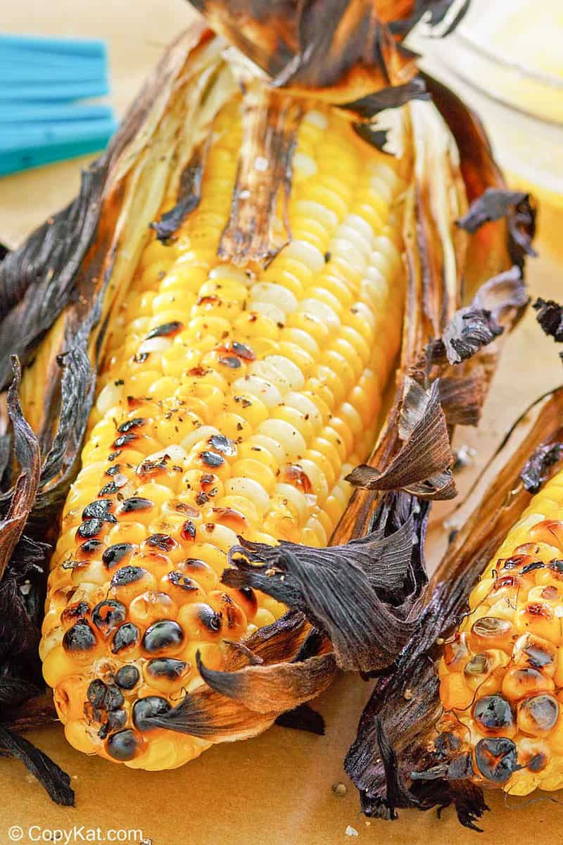 grilled corn on the cob on parchment paper