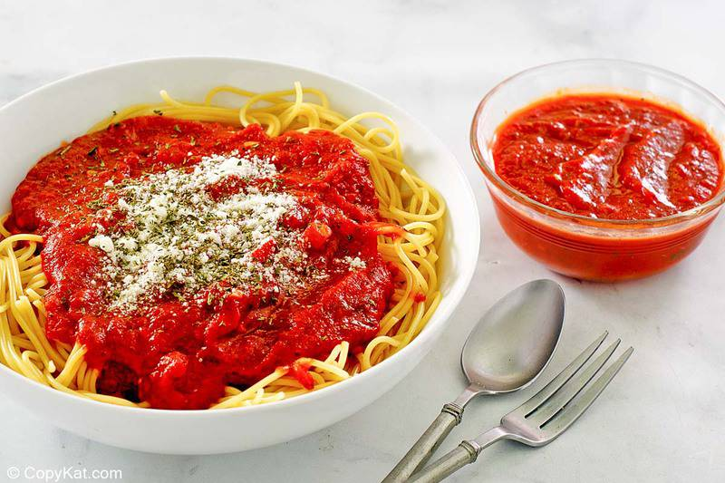 homemade spaghetti sauce on pasta and in a bowl