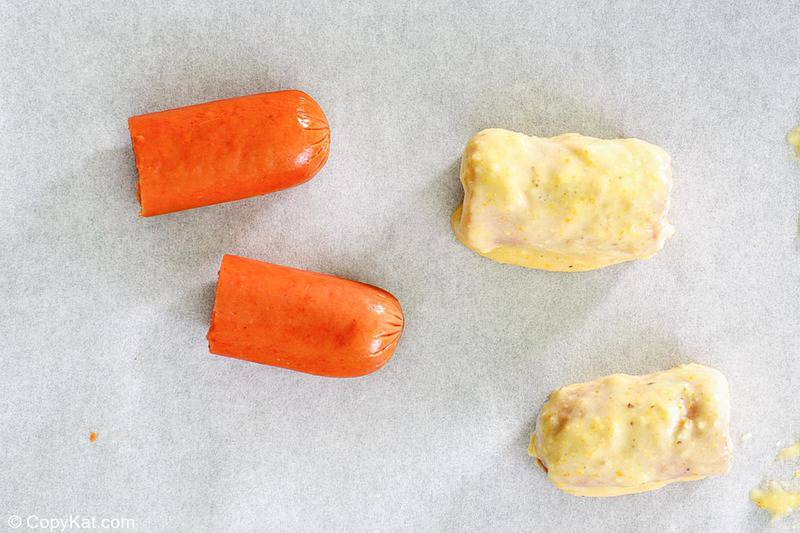 hot dogs cut and dipped in cornmeal batter.
