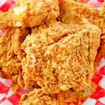 overhead view of homemade KFC fried chicken on parchment paper
