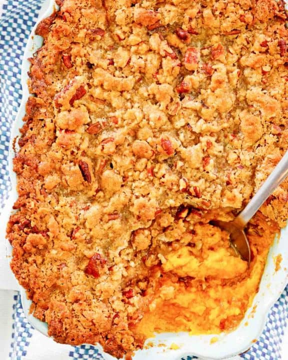 overhead view of sweet potato souffle with pecans in a baking dish.