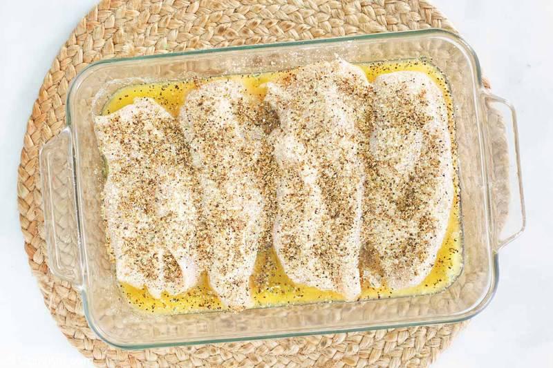 lemon pepper chicken in a dish before baking