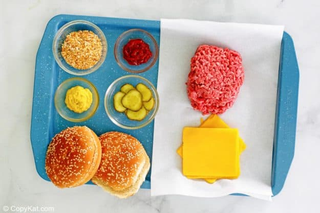 McDonald's quarter pounder ingredients on a tray