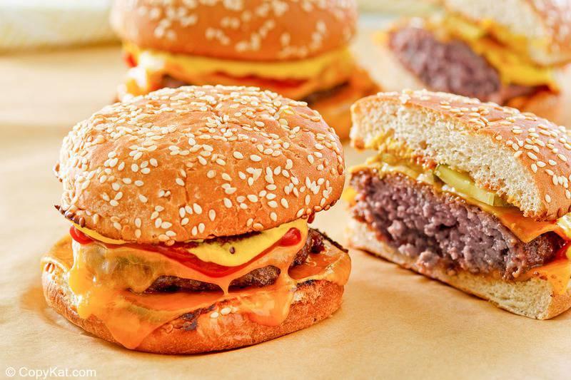 three homemade McDonald's quarter pounder burgers.